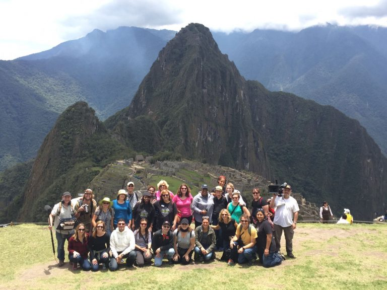 Gaby P. and friends in Peru with mountains in background