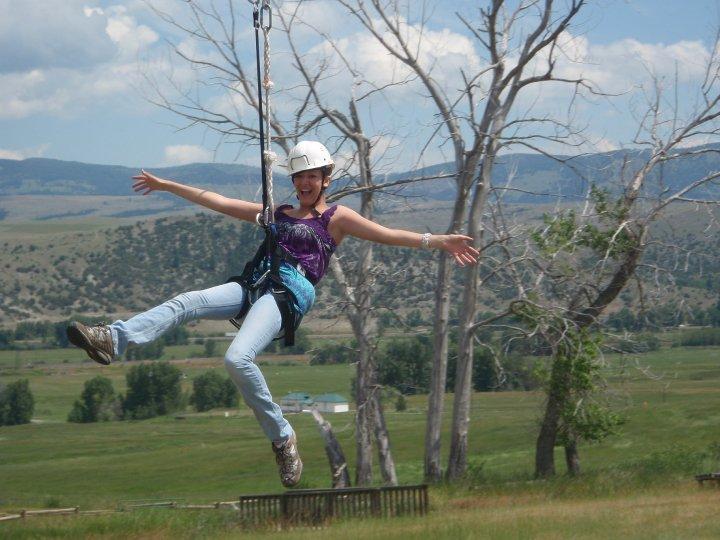 Kaitlin A riding a zipline